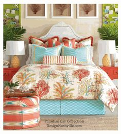 tropical bedding in orange, coral, aqua, white, and yellow. aquatic motifs and geometrics accent each other beautifully.