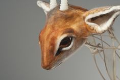 """dikdik / ghost dikdik, 2010, dimentions variable, materials: hog gut, reed, zip ties, resin, wax, wool, branches, found glass, found metal, technique: casting, felting              Dürer's Rhinoceros, 2011, 84"""" x 32"""" x 60"""", materials: resin, silicone, recycled textiles, flax., technique: casting, textile deconstruction, machine and hand sewing"""