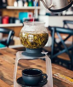 The Hario Tea Largo Bundle includes the Largo Tea Dripper, Stand and 500g of loose leaf tea! Make delicious tea at home with this unique pour over style!  #tea #tealovers #teabrewing