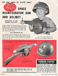 This kid looks pleased with his space disintegrator gun and helmet
