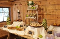 Reception food display - IDEA: I have a small laddar bookshelf like this we could use for the one table against the wall!!!!