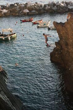 Cliff Jumping in Manarola, Cinque Terre, Italy, province of La Spezia , Liguria