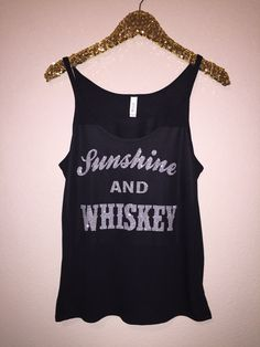 Sunshine and Whiskey - Glitter - Slouchy Relaxed Fit Tank - Ruffles with Love - Fashion Tee - Graphic Tee Black tank with silver glitter lettering. This tank is meant to be a relaxed fitting tank, keep that in mind when selecting your size :) - 3.7 oz., 65/35 polyester/viscose, 30 singles - Athletic Heather is 52/48 polyester/viscose - Triblends are 3.8 oz., 50/25/25 polyester/cotton/rayon, 40 singles - Black Mineral Wash* is 4.4 oz., 52/48 cotton/polyester, 30 singles - Slubs are 4.0 oz…