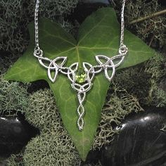 925 Celtic Trinity Knot Necklace with Oval Faceted Peridot and 16 Inch Box Chain Sterling Silver. $125.00, via Etsy.
