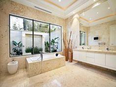 water feature beyond window is nice for private garden bathroom window