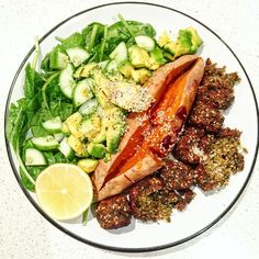 LUNCH DELIGHT⚡️⭐️ baked sweet potato and falafels with spinach salad of cucumber,avocado and lemon juice finished with a sprinkle of sesame seeds and cracked pepper