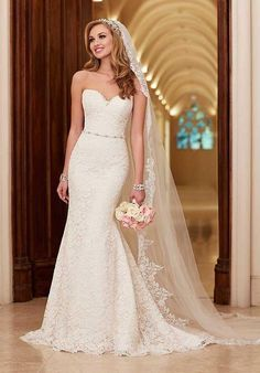 This lace over rich Dolce Satin, slim A-line bridal features a crystal beaded waist belt and a scalloped trim on its sweetheart bodice, hem, and chapel train | Stella York | https://www.theknot.com/fashion/6124-stella-york-wedding-dress