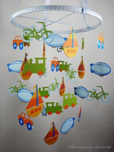 Transportation Mobile with Bike, Blimp, Car, Sailboat and Train by whimsicalaccents on Etsy. A decorative mobile for your child's bedroom or nursery.