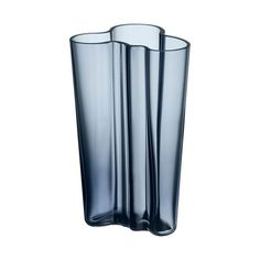 Inspired by the waves in water, it has become a staple of modern Scandinavian design. Each Alvar Aalto vase is unique and mouth blown at the Iittala glass factory in Finland.</p> <br/>As well as being a decorative piece, it can be used as a function vase or vessel to store items in.