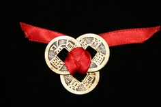 """Money Magnet: 3 Coins on Red 9"""" Ribbon placed inside your door to encourage prosperity chi = energy."""