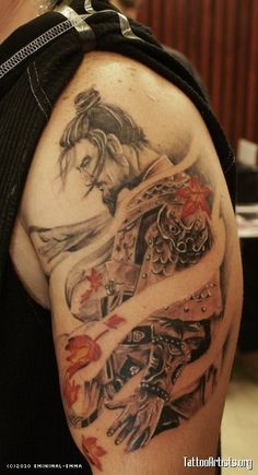 Cool samurai tattoo - love the detail of the hair and the combo of b w just a touch of color