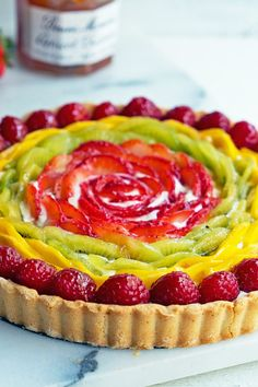 Recipe including course(s): Dessert; and ingredients: apricot preserves, cream cheese, egg, flour, kiwi, lemon zest, liqueur, mango, raspberries, strawberries, sugar, unsalted butter