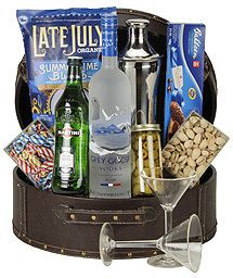 The Grey Martini Gift Basket: A bottle of Grey Goose Vodka, a martini shaker, vermouth, olives, nuts, cookies, candy and two martini glasses. $175.00 #fathersday #vodka #gifts #1877spirits