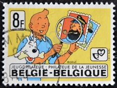 A stamp printed in Belgium shows the cartoon character, Tintin and his dog Snowy and captain Haddock, circa 1979