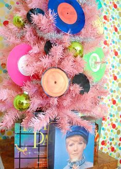 Shiny CDs, vinyl records, traditional ornaments and silver tinsel adorn the Pretty in Pink Christmas tree.