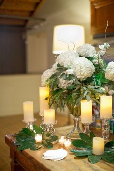 Don't think you can ever go wrong with Hydrangeas & Candles! See more of the wedding here: http://www.StyleMePretty.com/2014/05/15/elegant-white-wedding-in-georgia/ HarwellPhotography.com - #SMP - Floral Design: ByTulip.com - Event Planning: ComeTogetherEvents.com