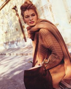 I've always admired the style of Italian women on the streets of Rome - layers of rich knits - shown here in a vintage Vittadini ad.