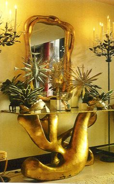 """Tony Duquette originally designed his  """"biomorphic console and mirror"""" for the Ducommon residence in Bel Air in the mid 1960s"""