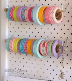 an idea to hang washi tape or ribbon on a knitting needle or chopsticks and hooks