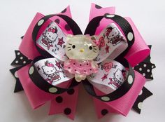 This cute little Miss Kitty hair bows is perfect for all the little girls who love Hello Kitty.  The bow is made on a partially lined alligator hair clip and can be attached to a headband or hat for a baby or little girl. Measures about 5 inches across. $8.00 http://www.etsy.com/shop/JustinesBoutique