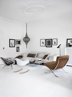 Scandinavian style living room. Brown leather Barcelona chair