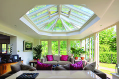 Airy comfort in this larger orangery with large sofas and contrasting soft furnishings