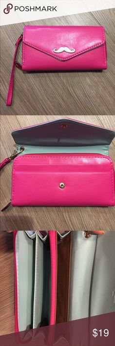 Cute Korean Clutch Wristlet Long Wallet hot pink Used and in good condition. Two mystery stains that I have not tried to remove. Snap cover closure and inner all around zip pockets (with a vent on one side for your smartphone, easily fit an iPhone 6+ inside). Card slots on the inside below the flap. Features a cute white mustache with golden edges. Removable handle. It feels smooth like leather, but it doesn't look like real leather, so I am unsure of what exactly it is made out of. I ship…