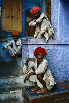 Asia | Three city workmen wait for their afternoon tea, delivered each day by a street vendor, in Jodhpur, India | © Steve McCurry