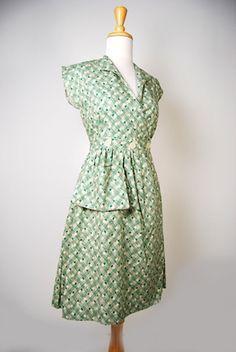 An authentic vintage reproduction of a timeless favorite cotton day dress! I love how she secures the wrap with buttons.