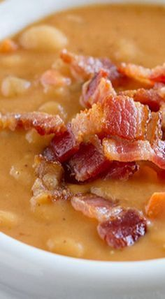 Homemade Bean and Bacon Soup -- Skip the can - this homemade soup is hearty and filling and filled with veggies and chunks of bacon! #YummySoup