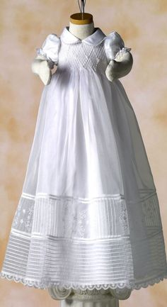 Smocked yoke Christening gown with heirloom sewing techniques on skirt.
