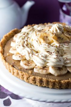 This recipe for No Bake Banoffee Pie from Erren's Kitchen makes a dazzling dessert layered with a graham cracker base, creamy caramel sliced bananas, and a whipped cream topping.