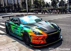 Wild BenSopra Nissan GT-R With Rainbow Vinyl Wrap,LCWD is the designer of this car Nissan Gt R, Nissan Gtr Nismo, Nissan Skyline R33, Gtr R35, Skyline Gtr, Fancy Cars, Cool Cars, Supercars, Sexy Autos
