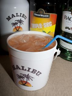 "Pirate's Punch  from my sweet baby sister  2 ounces Malibu Rum (can also use ""Black"") 2 ounces white rum  2 ounces triple sec  2 ounces creme de banana (I always use 99 bananas instead)  2 ounces pineapple juice  2 ounces orange juice  floater of dark rum  teaspoon – tablespoon grenadine"