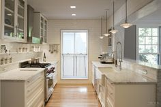 Detailed remodel  White Kitchen by architect David Wagner