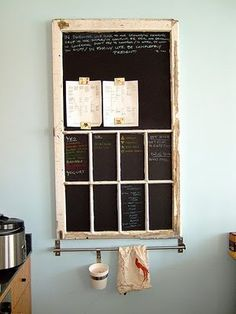 use an old window to create chalkboard/magnetic board with a hook system underneath.