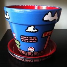 Super Mario Themed Flower Pot- then plant a Venus Fly Trap in it as a Piranha Plant lol