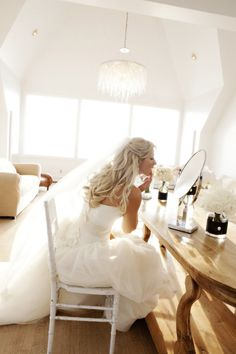 Wedding Dress: Vera Wang / Bride's Earrings, Hair Combs + Veil: Vera Wang / Bride's Shoes: Jimmy Choo
