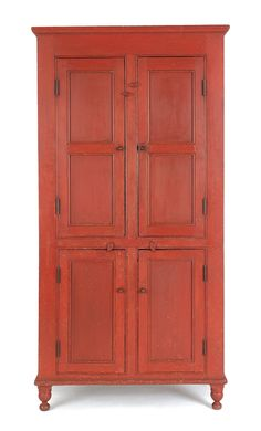 Pennsylvania painted pine cupboard, ca. 1820, retaining a red painted surface, 78 H. x 36 W. x 18.5 D.