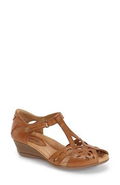 Free shipping and returns on Earth® 'Rosemary' Peep Toe Wedge Sandal (Women) at Nordstrom.com. Laser-cut leatherwork adds understated sophistication to a breezy, lightweight stacked-wedge sandal. Contoured, arch-supporting footbed with multidensity cushioning adds signature comfort to the style.