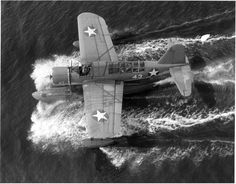 Overhead view of an OS2U Kingfisher making a water landing at Naval Air Station (NAS) Jacksonville, Florida ca.1943