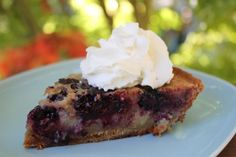Dewberry Custard Pie Recipe - in central Texas, during April/May, dewberries come into season just in time for our german family reunion.  This is my favorite way to eat them.