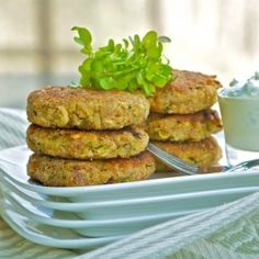 Crispy-tender zucchini cakes with tangy yogurt sauce. Great for vegetarian dinner.
