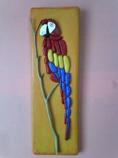 Hey, I found this really awesome Etsy listing at https://www.etsy.com/listing/228197023/parrot-pebble-wall-hanging