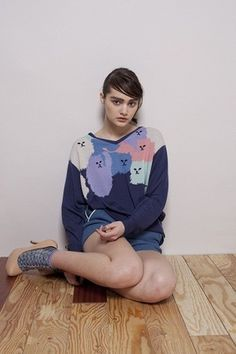 Weird cat sweater. But i like the colours.. and shes beautiful.