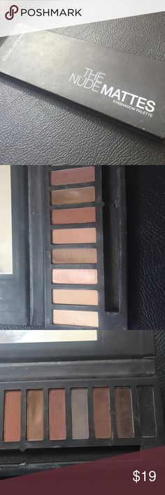 Paula's Choice Nude Matte Eyeshadow Cardboard Packaging is a little dirty, but the shadows are far from hitting pan. This is a similar dupe to the Kat Von D palette as far as colors and quality, but they aren't as powdery I find, so they don't have as much fallout. If you love all mattes, this is a good option. Plus, Wayne Goss helped create it, so you know it's good. Paula's Choice Makeup Eyeshadow