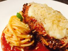 Although not a typically authentic Italian dish Chicken Parmigiana is taste made for enjoyment following classic Italian combinations. Originated from Zucchini or Eggplant Parmigiana recipes this dish was created by Italian Immigrants in the United States and has since become a favourite Italian dish around the world. The combination of succulent breaded chicken and layers of melted cheese makes it hard to resist. Italian Main Courses, Chicken Parmigiana, Taste Made, Breaded Chicken, How To Make Cheese, Classic Italian, Melted Cheese, Italian Dishes, Eggplant