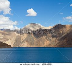 Pangong Tso mountain lake panorama with mountains and blue sky reflections in the lake (Ladakh, India)