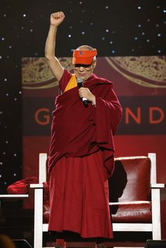 News Photo: His Holiness the Dalai Lama speaks onstage at the One World Concert at Syracuse University on October 9, 2012 in Syracuse, New York. (Photo by Neilson Barnard/Getty Images for Syracuse University) @Syracuse University