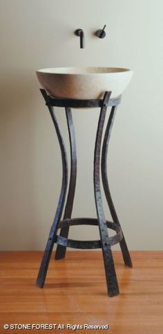Hand-forged #Iron Ribbon Pedestal with a #Perlato Svevo urban vessel from @Stone Forest will complement any bathroom.